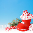 Santa's boot and Xmas sweets — Stock Photo #33387337