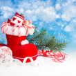 Xmas decorations and sweets on blue background — Stock Photo