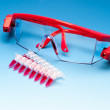 PCR samples and protective glasses — Stock Photo