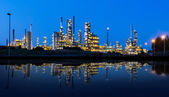 Modern factory reflected in a lake at night — Stock Photo