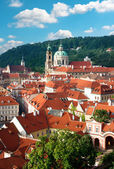 Prague, St. Nicolas church and rooftops — Stock Photo