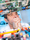 Senior eletronics engineer lost in thought — Stockfoto