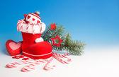 Santa's boot and Xmas decorations — Stock Photo