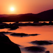 Stock Photo: Golden sunset over shallow water