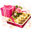Valentine chocolates and a gift box — Stock Photo