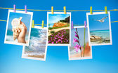 Collage of travel pictures hanging on ropes — Stock Photo