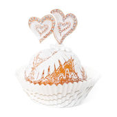Cupcake decorated with white fondant and two hearts — Stock Photo