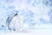 Christmas decorations, silver and white on blue — Stock Photo