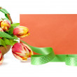 Basket of tulips and an orange envelope — 图库照片