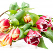 Bunch of tulips in a vase shaped as a basket — Stock Photo