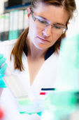Scientist works in modern laboratory — Stock Photo