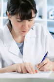 Scientist or a medical student writing — Stock Photo