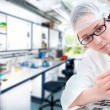 Young tech tunes her microscope — Stock Photo #33481351
