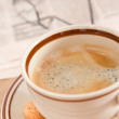 Cup of coffee and morning news — Stock Photo