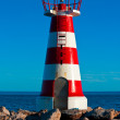 Small lighthouse in Cuarteira, Portugal — Stock fotografie