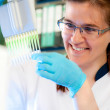 Stock Photo: Scientist loads samples for DNanalysis