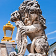 Stock Photo: Lion statue flanking main entrance to Nymphenburg Castle