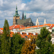 Prague castle and tiled roofs of old Prague — Stock Photo