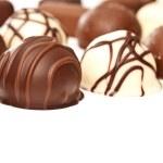 Chocolate pralines isolated on white — Stock Photo