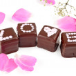 Word LOVE spelled on chocolate pralines — Stock Photo