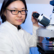 Young oriental microscopist — Stock Photo #33482125