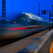 Speed train leaving train station at night — Stock Photo