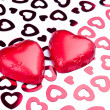 Stock Photo: Two chocolate hearts wrapped in red foil