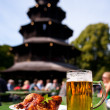 Beer and chicken in Munich Beer Garden — Stock Photo