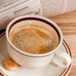 Coffee and financial newspaper — Stock Photo