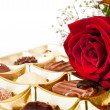 Valentine chocolates and a rose — Stock Photo