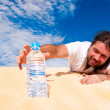 Thirsty man reaching for a bottle of water — Foto Stock