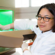 Stock Photo: Oriental scientist works in lab