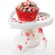 Cupcake decorated with pink hearts — Stock Photo
