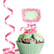 Ornate green-pink cupcake on white background — Stock Photo