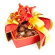 Valentine chocolates and a rose isolated on white — Stock Photo