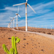 Stock Photo: Rusty windmills working