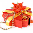 Decorated gift box in a shape of a heart with a rose on top — Stock Photo