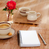 Notebook with pen and morning coffee — Stock Photo