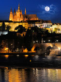 Evening view of Prague Castle and Charles Bridge from Novotneho — Stock Photo