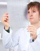 Medtech checks results of cariotype test — Stock Photo