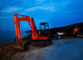 Front loader on curvy Greek road — Stock Photo
