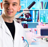 Young scientist in modern laboratory — Stock Photo