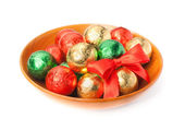 Chocolate candy balls in a plate — Stock Photo