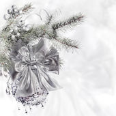 Xmas tree branch decorated in silver — Stockfoto