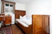 Traditional european sleeping room — Stock Photo