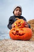 Boy and halloween pumpkins — Stock Photo