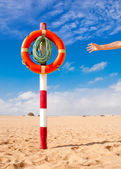 Hand reaches for Life Buoy — Stock Photo