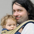 Father carries his son in sling baby carrier — Stock Photo