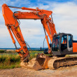 Large orange excavator — Stock Photo