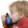 Baby boy with toy in his mouth — Stock Photo